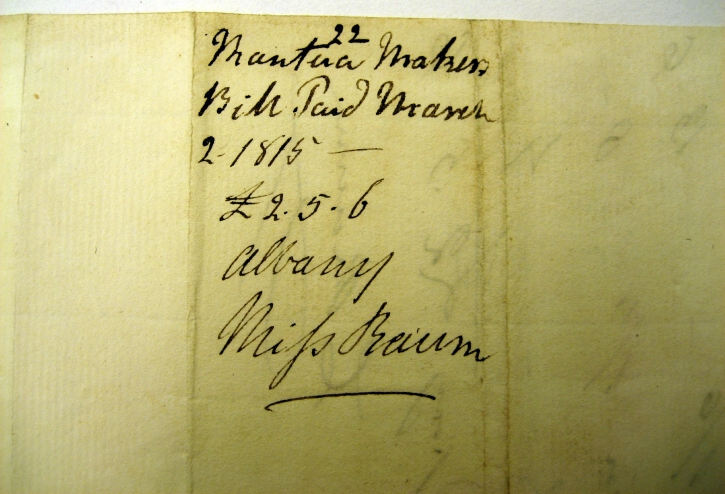 G Clarke's notation for paying mantua maker for Mrs. C's plaid dress