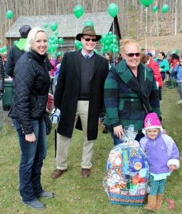Mary T Clarke and Jon Maney with Neaveh Butler of Milford, winner of the Hyde Hall Easter Basket