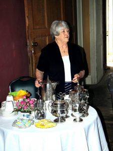 Arlene Bower serving tea at Hyde Hall Celebrate Mom! Garden Party.