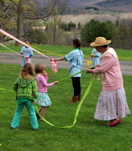 Mary Margaret Kuhn leads the Maypole Dancers.